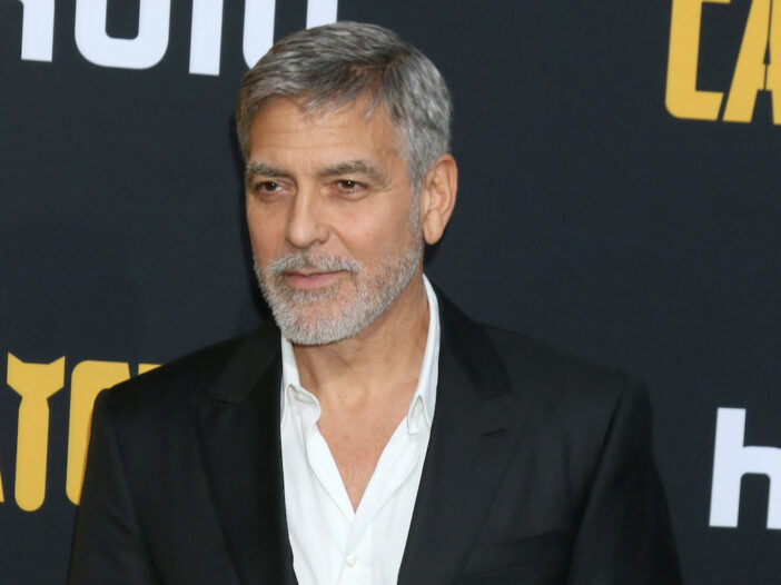 George Clooney in a black suit and blank expression