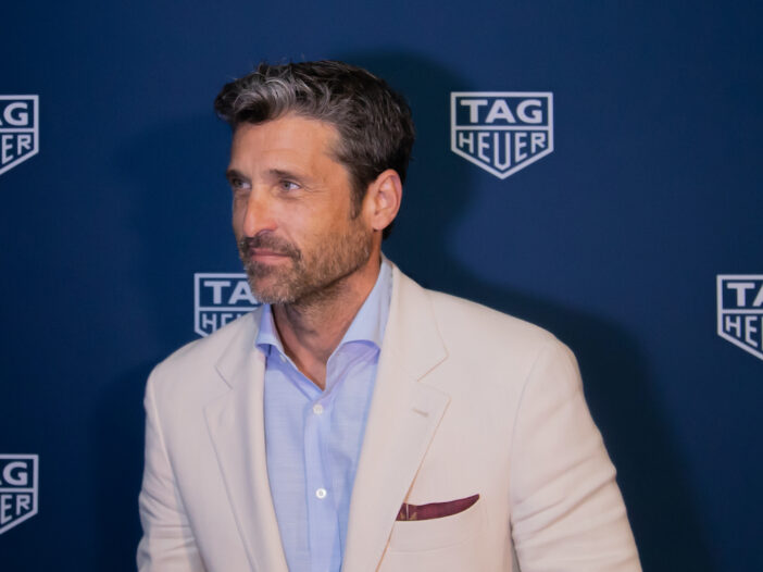 Patrick Dempsey in a white coat and blue shirt