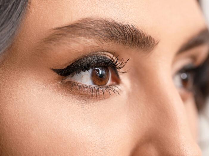 Upclose image of woman's winged eyeliner.