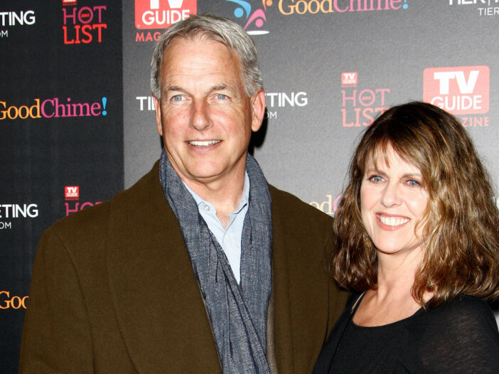 Mark Harmon smiling in a brown coat with wife Pam Dawber
