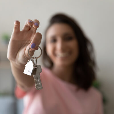 Image of a woman holding up a pair of keys.