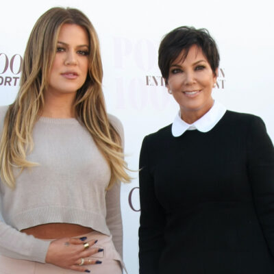 Khloe Kardashian in a grey crop top with Kris Jenner in black