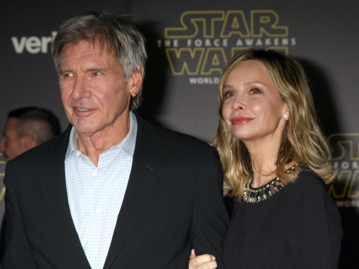 Harrison Ford in a suit with Calista Flockhart in a black dress