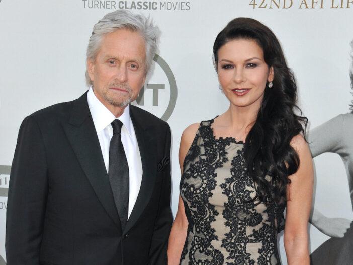 Michael Douglas in a suit with Catherine Zeta Jones