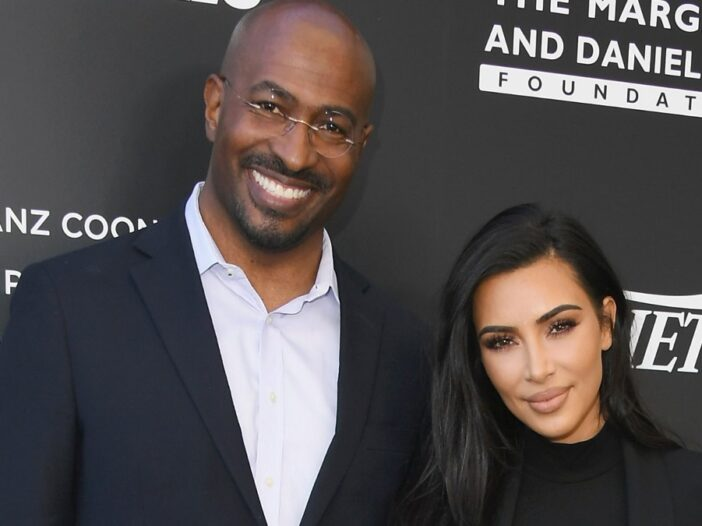 Van Jones, in a black suit jacket and white shirt, stands before a black background with Kim Kardashian, also in black