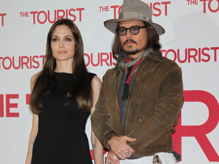 Angelina Jolie standing with Johnny Depp
