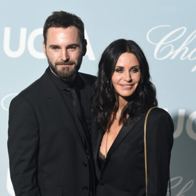 Johnny McDaid and Courteney Cox smiling in black outfits