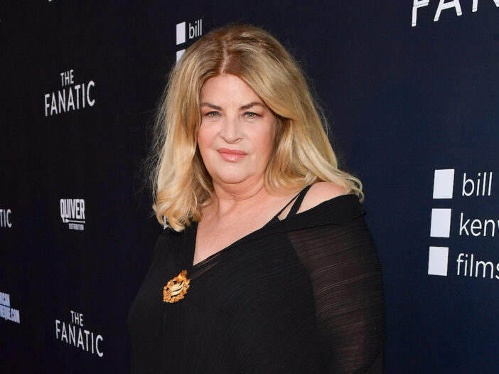 Kirstie Alley smiling in a black dress