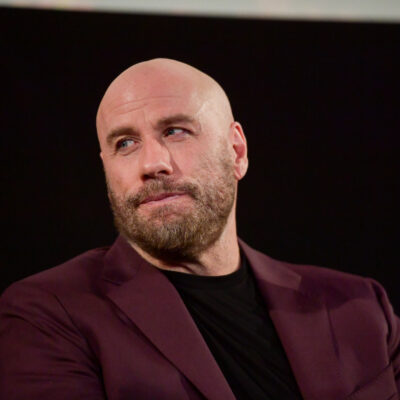 John Travolta in a maroon jacket