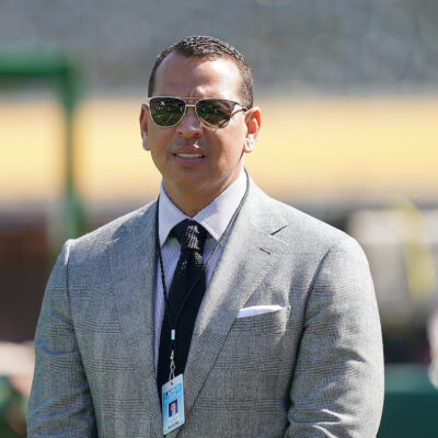 Alex Rodriguez in a grey suit outdoors