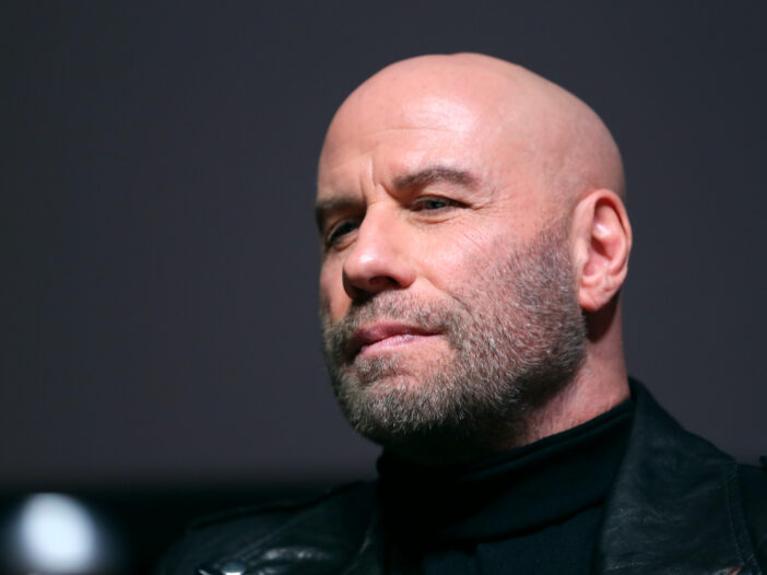 close up of John Travolta in a leather jacket