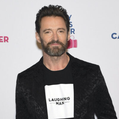 Hugh Jackman in a black jacket and t-shirt