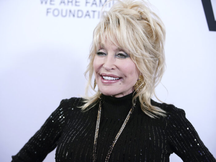 Dolly Parton smiling in a black top