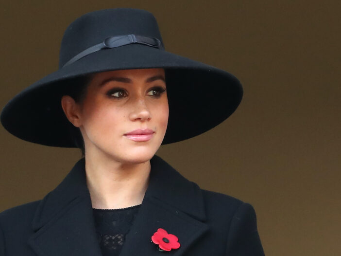 Meghan Markle in a black coat and hat