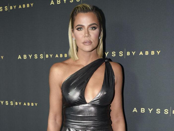 Khloe Kardashian in a grey dress