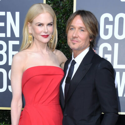 Nicole Kidman in a red dress, Keith Urban in a black suit