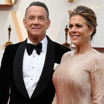 Tom Hanks in a tuxedo with Rita Wilson in a tan dress