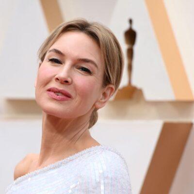 close up Renee Zellweger in a white dress