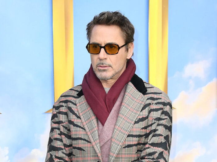 Robert Downey Jr. in a tan coat and red scarf