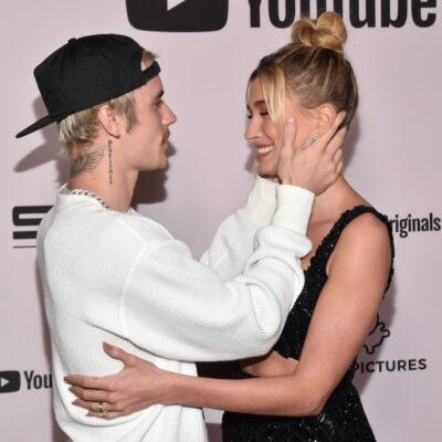 Justin Bieber grabbing Hailey Baldwin's face