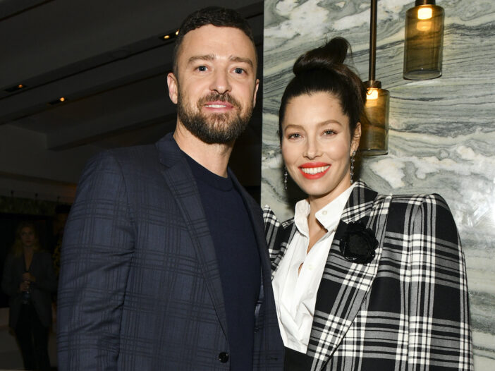 Justin Timberlake in a navy coat with Jessica Biel in a plaid coat