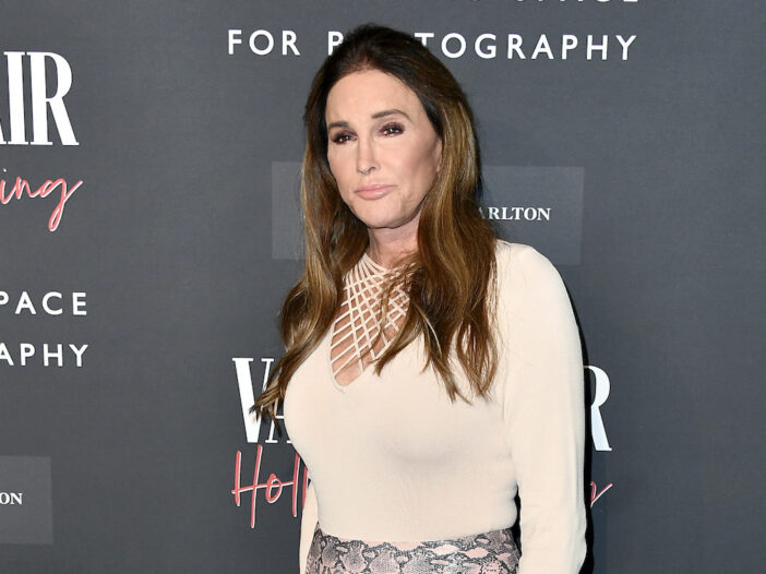 Caitlyn Jenner in a light tan top against a black background