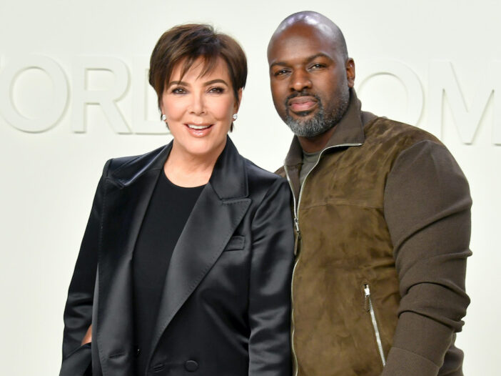 Kris Jenner in a black leather jacket with Corey Gamble in a brown jacket