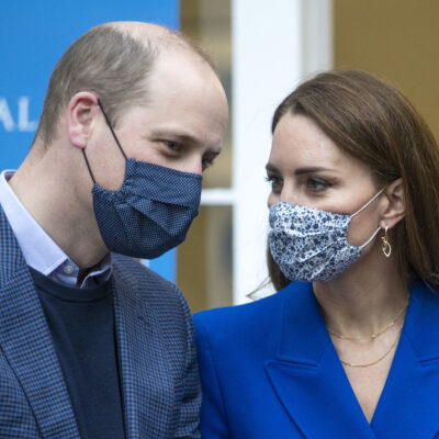 Prince William and Kate Middleton speaking wearing face masks