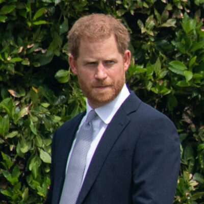 Prince Harry in a blue suit outdoors