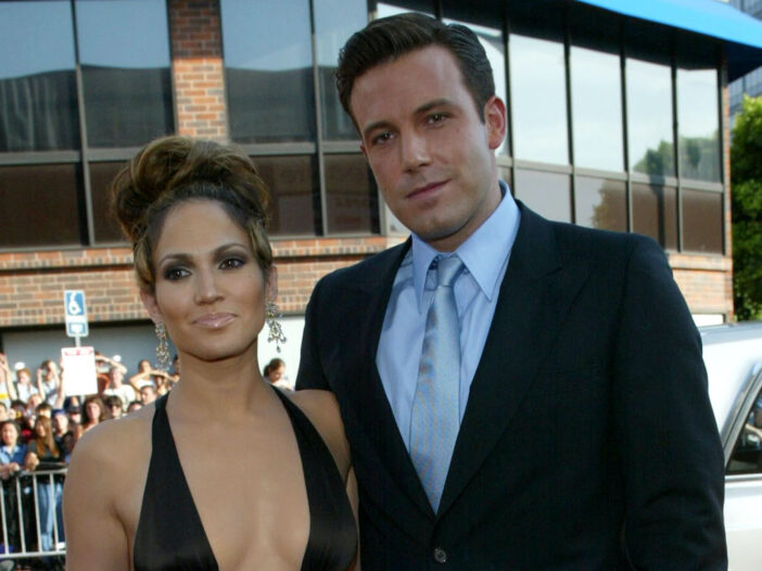 Jennifer Lopez in a brown dress with Ben Affleck in a navy suit