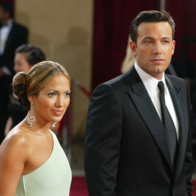 2003 photo of Jennifer Lopez in a green dress with Ben Affleck in a suit