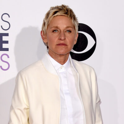 Ellen DeGeneres in a white outfit against a white background