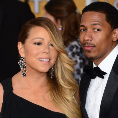 Mariah Carey in a black dress with Nick Cannon in a tux