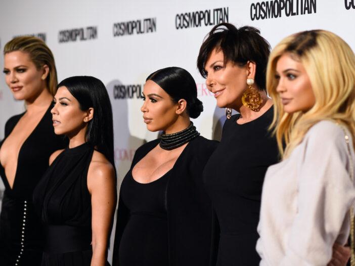 Khloe, Kourtney, and Kim Kardashian standing with Kris and Kylie Jenner