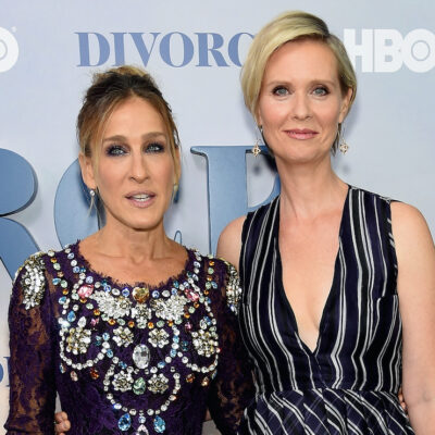 Sarah Jessica Parker and Cynthia Nixon smiling next to each other
