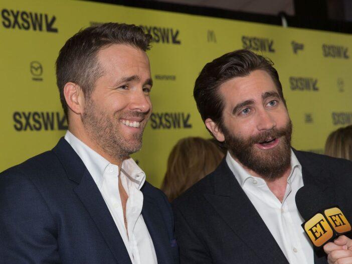 Ryan Reynolds in a black suit with Jake Gyllenhaal in a black suit