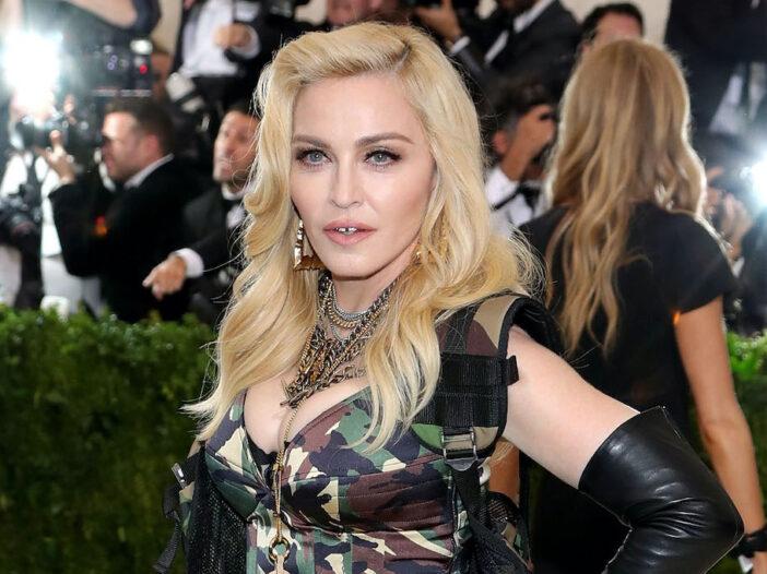 Madonna posing in a camo dress