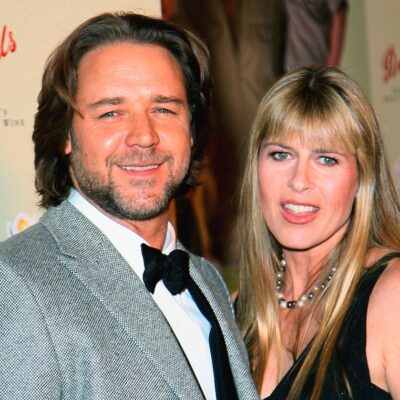Russell Crowe and Terri Irwin posing together in the 2000s