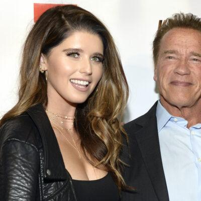 Katherine Schwarzenegger in a leather jacket with father Arnold Schwarzenegger in a suit