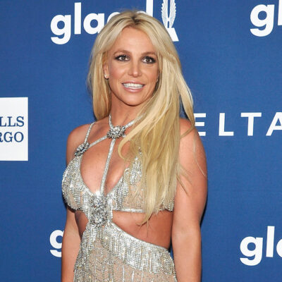 Britney Spears smiling in a silver dress