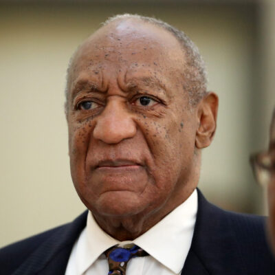 Bill Cosby returns to the courtroom after a break with his spokesman Andrew Wyatt at the Montgomery County Courthouse, during his sexual assault trial sentencing