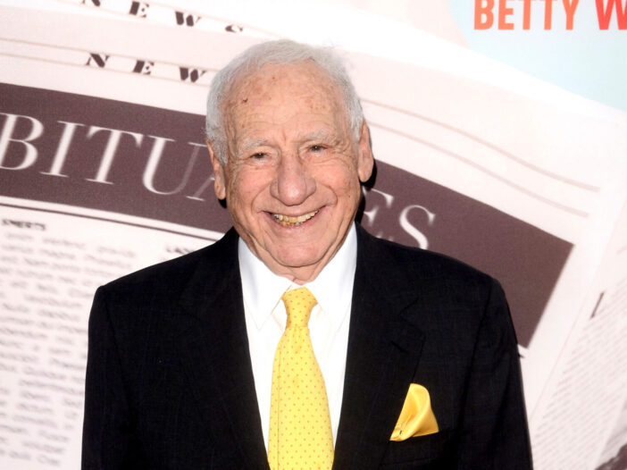 Mel Brooks wearing a suit and yellow tie