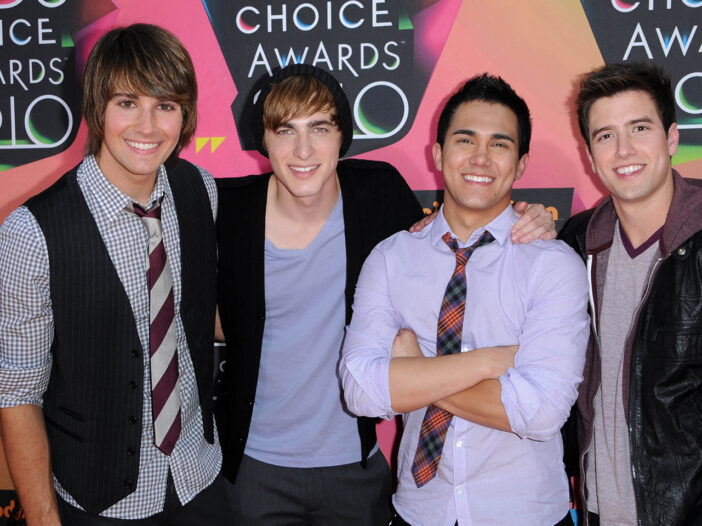Big Time Rush together at a red carpet event.