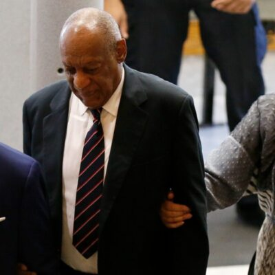 (Pool/Getty Images) Bill Cosby wearing a suit and tie and Camille Cosby smiling with sunglasses at 2017 trial