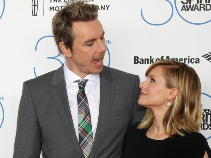 Dax Shepard speaks with wife Kristen Bell as the two pose for photos on the red carpet