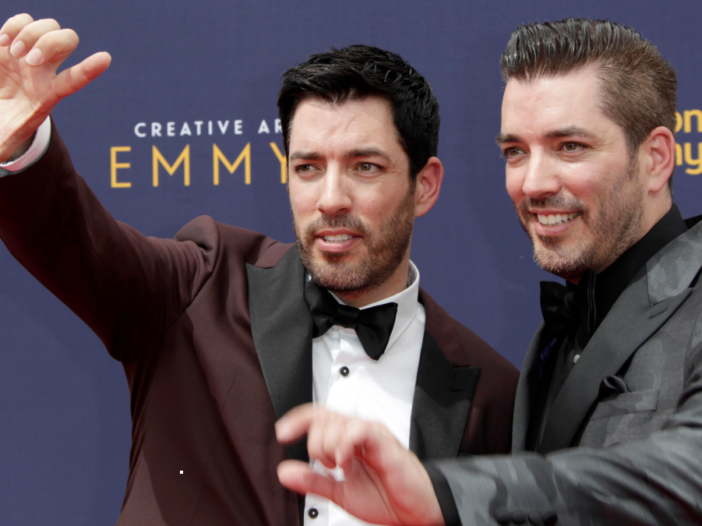 Drew and Jonathan Scott pose for pictures at the Emmy Awards red carpet