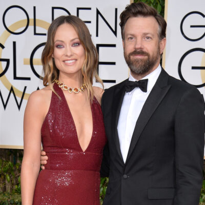 Olivia Wilde in a red dress, Jason Sudeikis in a tux on the right