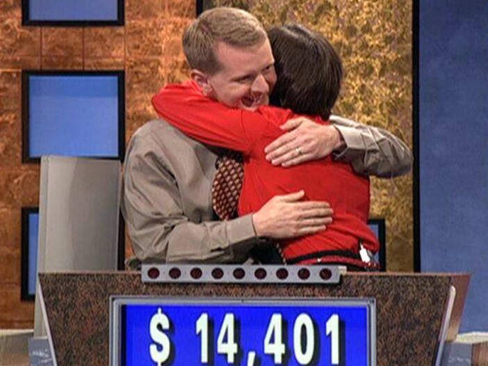 Ken Jennings hugs a fellow contestant on the set of Jeopardy!
