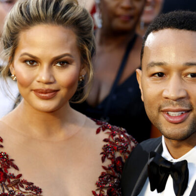Chrissy Tiegen on the left, John Legend on the right, together at an event in formal wear