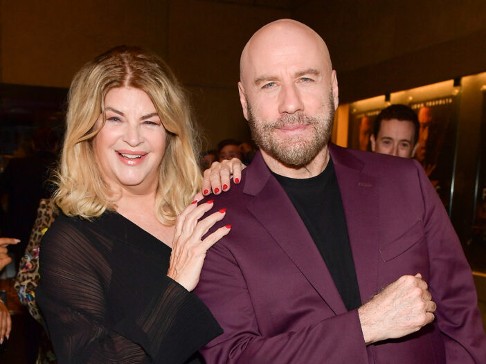 Kirstie Alley on the left, smiling with John Travolta